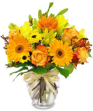 Cheerful blooms in a recycled glass vase