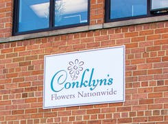 An exterior photo of our storefront, featuring the Conklyn's sign